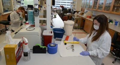 Two students working in a laboratory, distanced apart